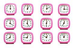 在whi从12:00到1:00上午和PM隔绝的时钟的汇集 库存照片
