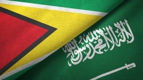 圭亚那和沙特阿拉伯旗子纺织品布料 皇族释放例证