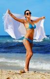 地中海海滩的少妇 免版税库存图片