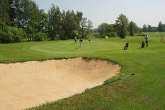 地堡高尔夫球运动员 免版税图库摄影