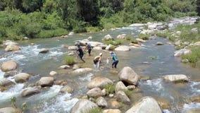 地方人抓住鱼用标尺手把放入袋子在河上 影视素材