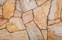 地板、墙壁或者道路的自然黄色路面石头纹理 免版税库存照片