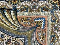 地毯用手编织与美好的坚苦工作的五颜六色的样式 图库摄影