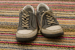 地毯运动鞋 图库摄影