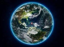 地球上的多米尼加共和国在晚上 免版税库存照片