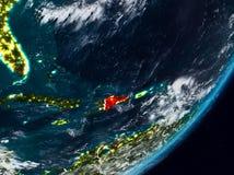 地球上的多米尼加共和国在晚上 免版税库存图片