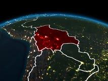 地球上的玻利维亚在晚上 免版税库存照片