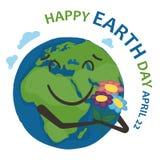 地球世界行星拿着花束花和微笑 图库摄影
