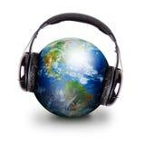地球全球耳机音乐 库存图片