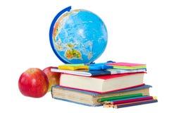 地球和书 免版税库存图片