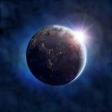 地球和太阳 免版税库存图片