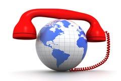 地球和电话接收器 库存图片