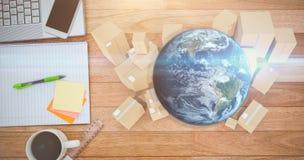 地球和纸板箱的综合图象 库存图片