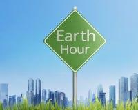 地球在交通标志的小时问候 图库摄影
