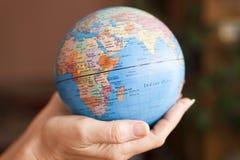 地球在手上 免版税图库摄影