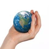 地球在手中 免版税库存图片