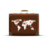 地球地图在一个棕色手提箱的 图库摄影