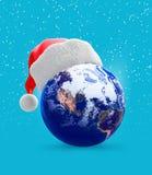 地球地球帽子圣诞老人 免版税库存图片