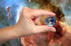 地球手指 免版税库存图片