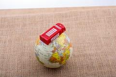 地球有电话亭帆布背景 免版税图库摄影
