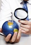 地球玻璃扩大化下 免版税库存照片