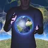 地球盘旋在手之间 库存照片