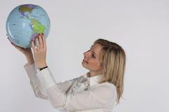 地球藏品妇女年轻人 免版税库存图片