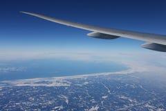 地球飞机翼 库存图片