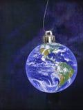 地球,世界圣诞节样式中看不中用的物品 背景看板卡祝贺邀请 免版税库存图片