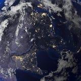 地球从空间3d翻译的夜视图 免版税库存照片