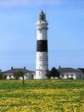 坎彭灯塔在叙尔特岛海岛上的在5月 图库摄影