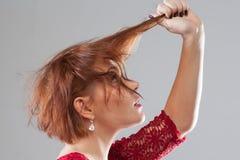 坏天,掉头发 发型广告 库存图片