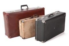 坏的多灰尘的老手提箱三 免版税库存图片