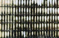 坏的波纹状的混凝土墙背景 免版税库存图片
