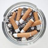 坏的烟灰缸 免版税库存照片