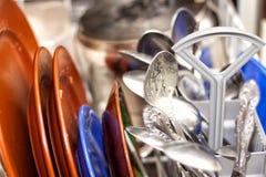 坏的盘洗碗机 免版税库存照片
