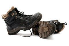 坏的老鞋子温暖 库存图片