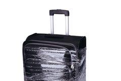 坏被包裹的手提箱透明影片 免版税图库摄影
