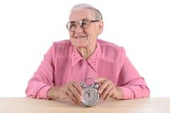 坐与时钟的妇女 免版税库存图片