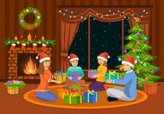 坐在客厅的家庭在地板在壁炉和装饰的圣诞树,交换xmas礼物 免版税库存照片
