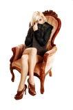坐在扶手椅子的女孩。 免版税库存照片