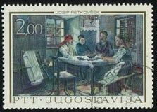 坐在桌上的家庭Josip Petkovsec 库存图片