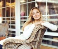 坐在椅子的可爱的妇女 库存图片