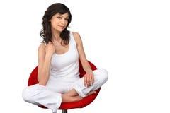 坐在椅子的妇女 免版税库存照片