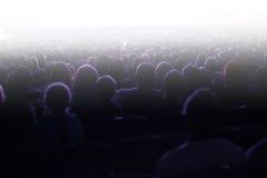 坐在观众的人们 免版税库存图片