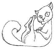 坐在角落的狡猾的动画片猫 免版税图库摄影
