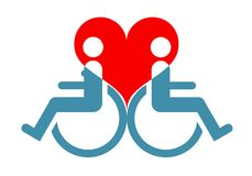 坐在轮椅的残疾恋人的标志反对ba 免版税库存图片