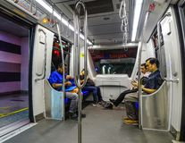 坐在LRT火车的人们 图库摄影