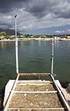 坐海湾的船坞 免版税图库摄影