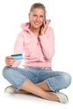 坐的妇女年轻人 免版税图库摄影